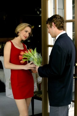 man giving a bunch of roses to woman