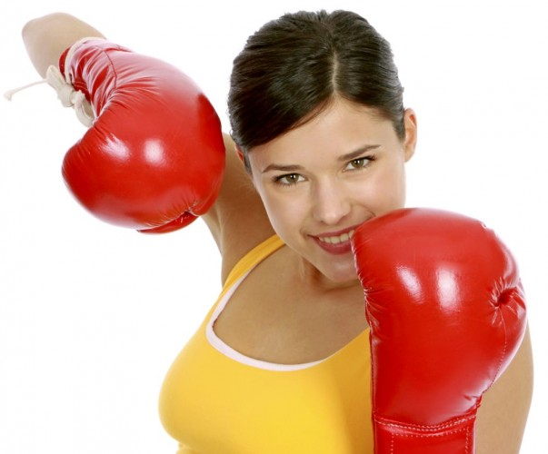 junge Frau in Sportdress beim Boxtraining,  woman wearing boxing gloves