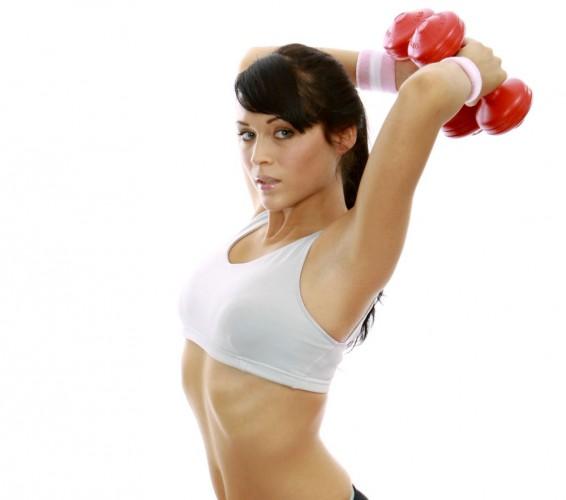 Frau bei übungen mit einem Gymnastikball, Woman exercising on a fitness ball