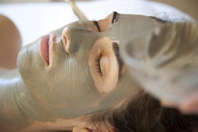 woman getting facial mask