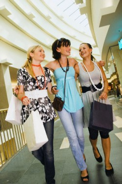 Teen girls walking together in shopping center