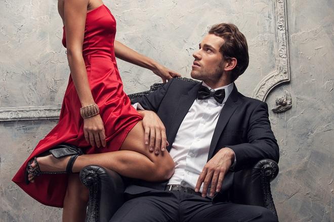 Elegant couple passing in classic clothes.