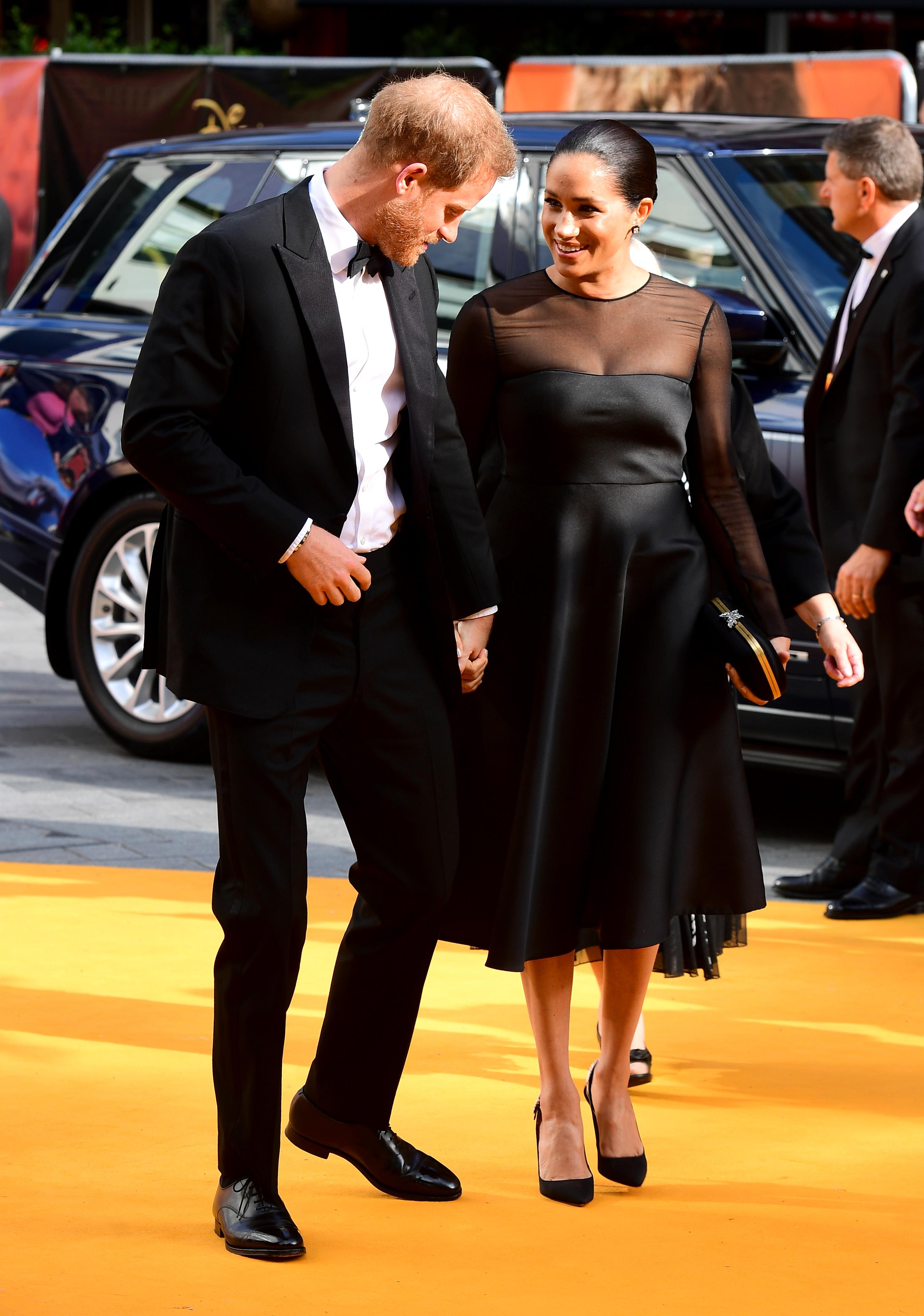 Meghan Markle și Prințul Harry, premieră Regele Leu, 14 iulie